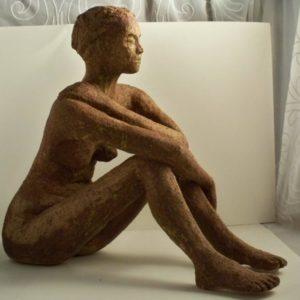 Female brown glazed ceramic figure , sandra jones sculpture
