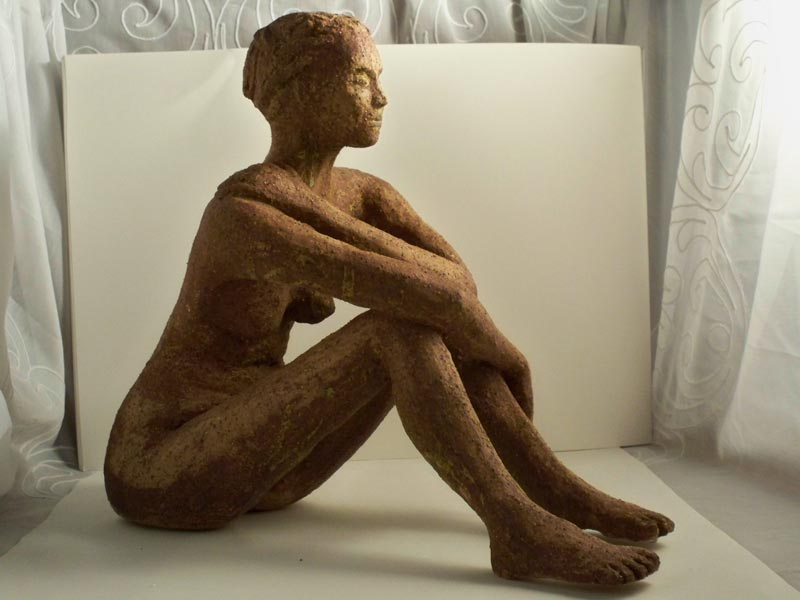 Female brown glazed ceramic figure , sandra jones sculpture