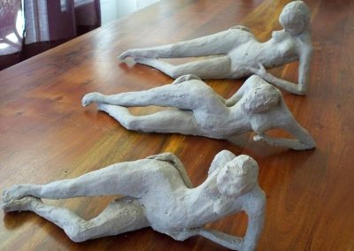 Reclining nude figures $200 each