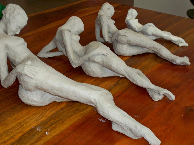 reclining stoneware figures by sandra jones